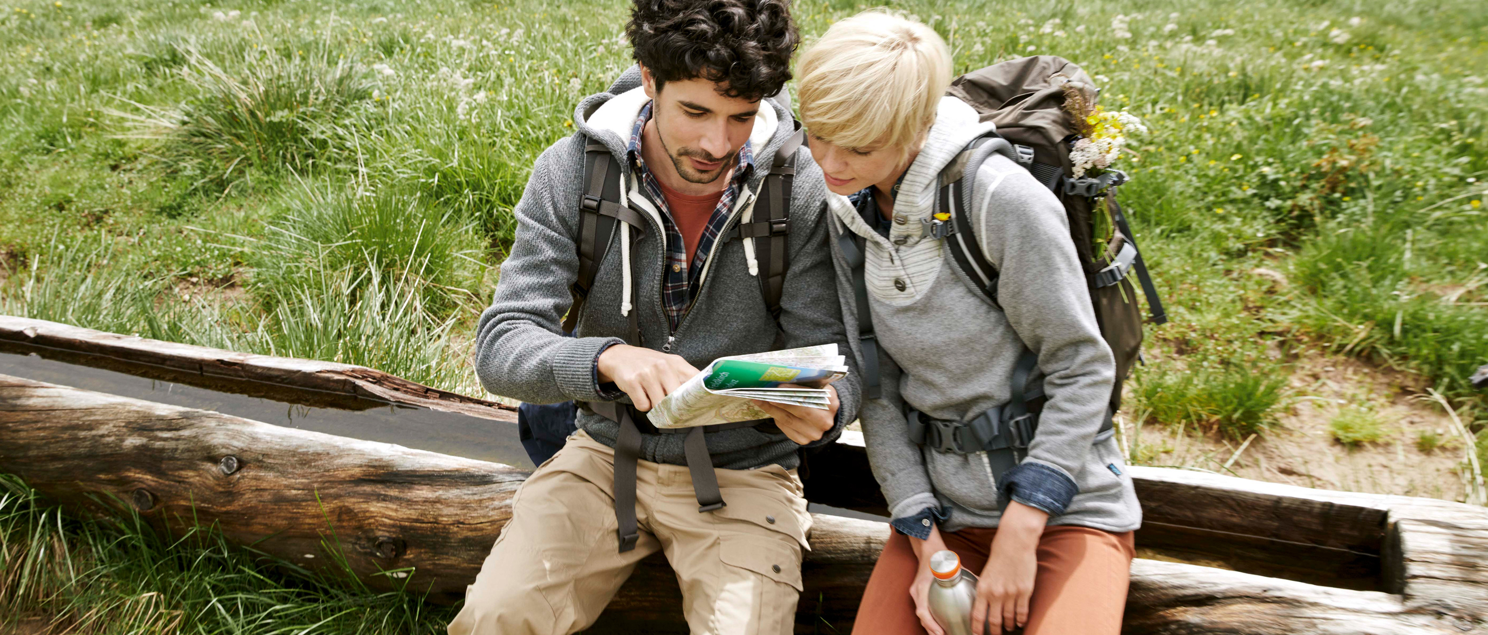 Couple studying hiking map